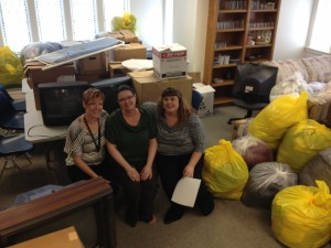 Episcopal Wichita Area Refugee Ministries staff with items donated by Hesston College students. Clothing, television, office supplies and even toiletries were given to local refugee families who arrived in the United States in the spring of 2013.