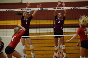 Freshmen RaeLee Hightower and Brooke Hershberger go up for a block. Photo by Masayo Satoh