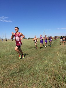 Wyatt Baer breezes past a pack of runners at Hutchinson. Photo Credit: Eva Dwyer