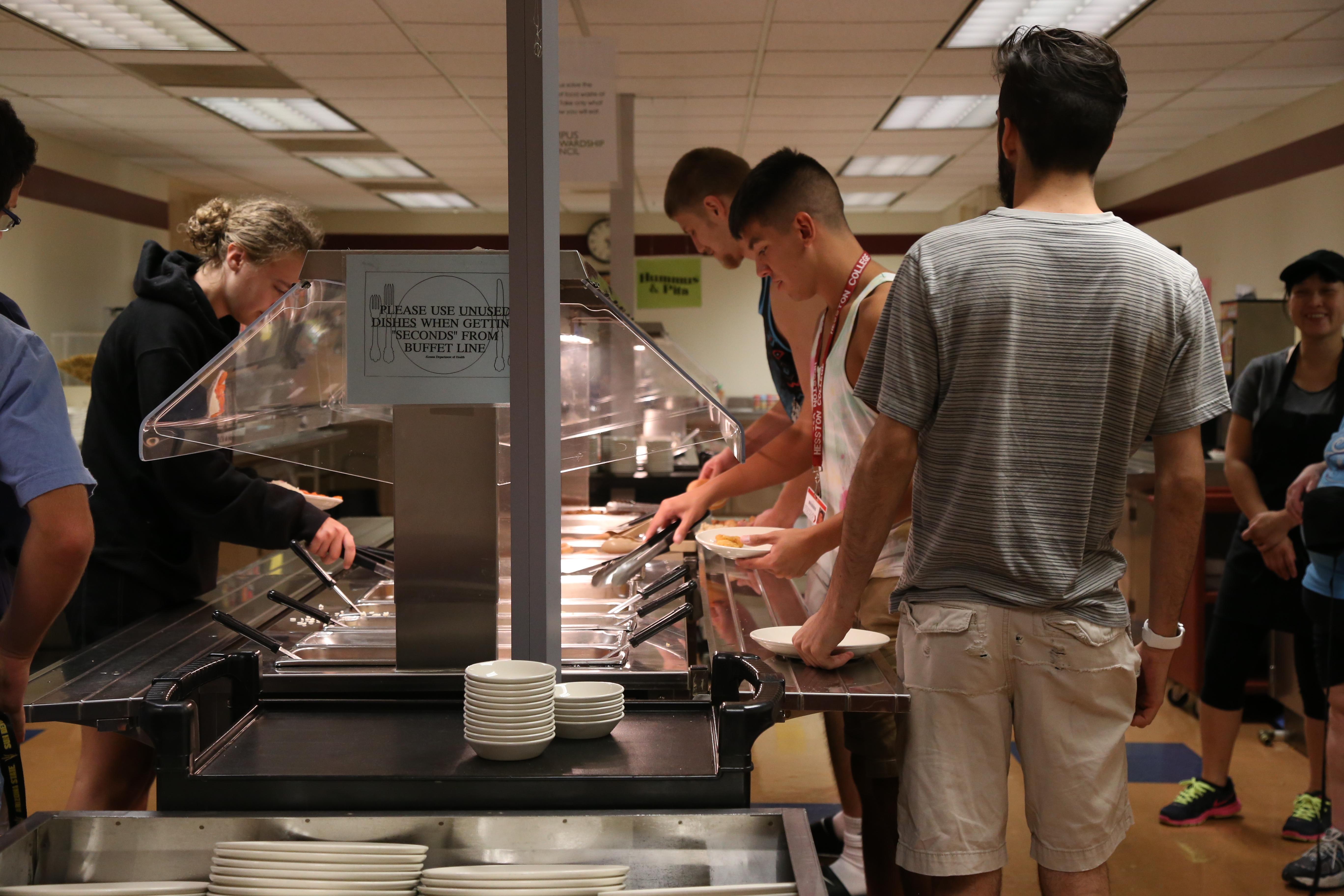 Students go through the cafeteria line. Many students hurry through the line, not considering how to use the cafeteria food to their benefit. Photo by