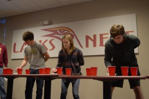 "Collin Leonard, Morgan Leavy, and Hayden Pentecost playing the Minute to Win it game ""Separation Anxiety"". Photo by Meredith Spicher"