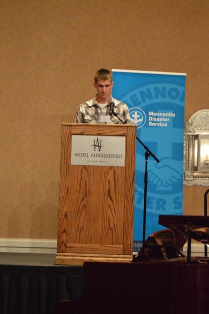 Sophomore Lane Schrock addressing the audience at the Mennonite Disaster Service Annual Meeting. Photo by
