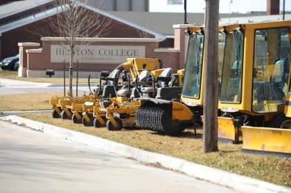 In a show of support for Excel Industries, the Hesston College maintenance department lined up their fleet of Hustler machinery on Main Street.