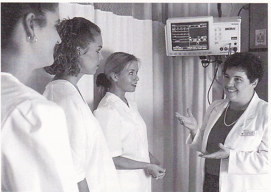 Ruby Graber instructs student nurses in the clinical setting.  Photo courtesy of the Hesston College Nursing Department.