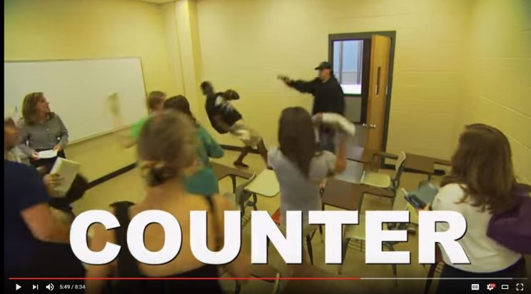 "Auburn University Active Shooter Response Training video depicts the ""Counter"" option, where students try to distract a shooter by yelling and throwing things. (YouTube)"