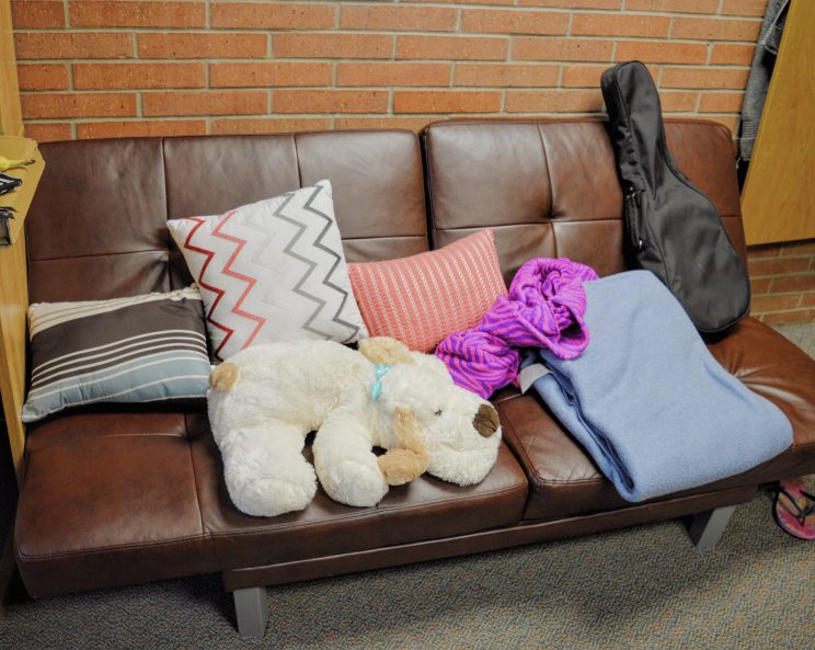Roommates Lilian Trifena and Yedidiya Zewdu decorated their couch with some colorful pillows and blankets.