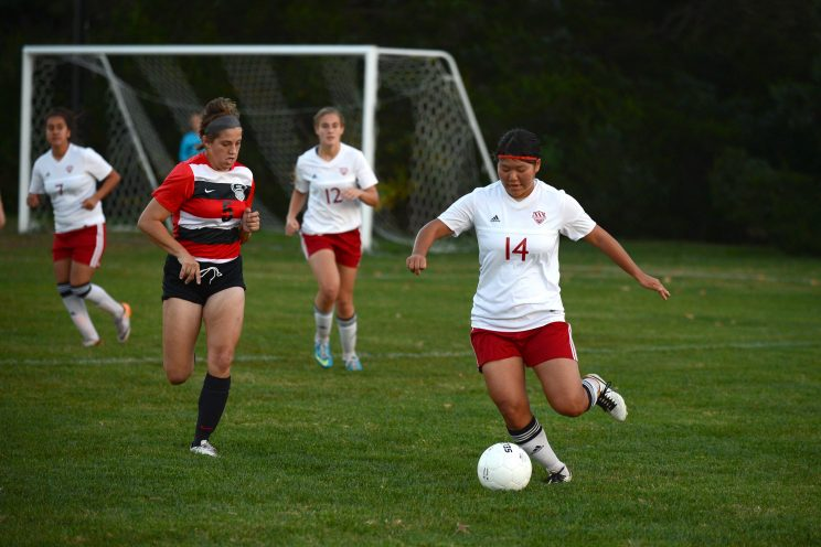 Miho Okuda chases down the ball against Coffeyville. Photo by Larry Bartel