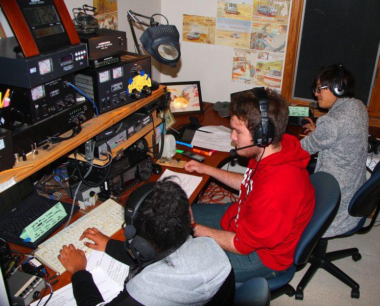Yedidiya Zewdu, Ryan Oostland and Ryuki Kawamoto at work at the radio.  Photo courtesy of Bob Harder
