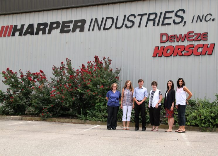 Wyatt Baer (So. Marshallville, Ohio) stands outside Harper Industries, Harper, Kan. with coworkers from the company's accounting department.