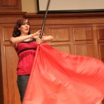 Sophomore, Amy Repp, shows off her talent in Flag Twirling, as part of a dance with Megan Goodrich.