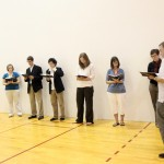 Faculty and staff gather for a hymn sing last Monday in the racquetball court.