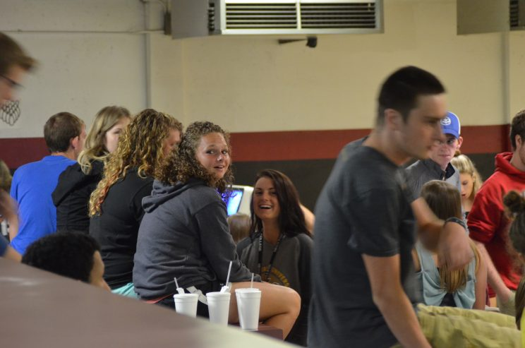 Students hang out at a local bowling alley as part of a Campus Activities Board event.