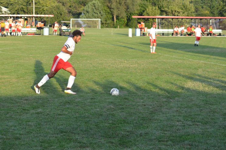 Thomas Minor (So.) goes in for a kick